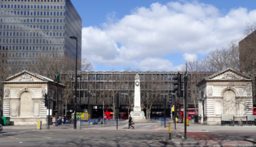 Euston Road at corner of former Euston Grove, showing bus entrance to Euston Station, 2013.